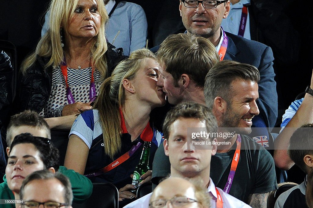 British cyclists Laura Trott and Jason Kenny kiss during the Beach Volleyball on Day 12 of the London 2012 Olympic Games at Horse Guards Parade on...
