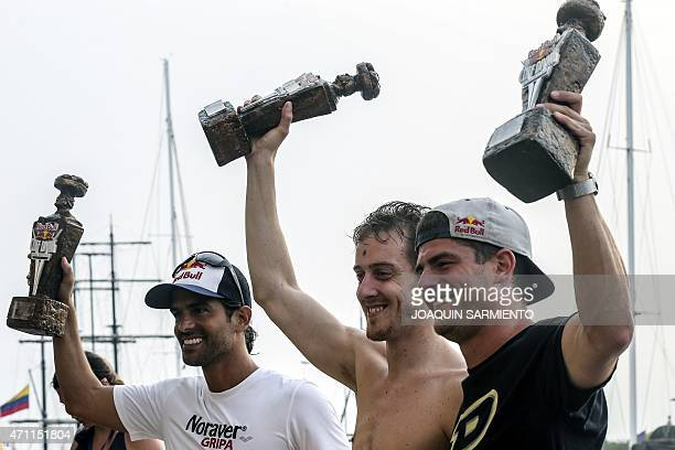 British David Hunt US David Culturi and Colombian Orlando Duqe celebrate their first second and third place respectively at the podium of the Red...