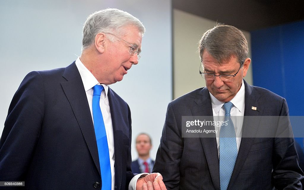 British Defence minister Michael Fallon (L) and US Defense Secretary Ashton Carter (R) speak to each other prior to the start of a NATO Defence Ministers meeting at the NATO headquarter in Brussels, Belgium on February 10, 2016.