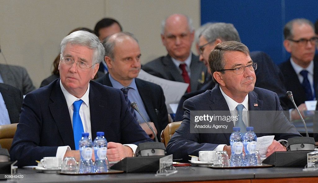 British Defence minister Michael Fallon (L) and US Defense Secretary Ashton Carter (R) attend the NATO Defence Ministers meeting at the NATO headquarter in Brussels, Belgium on February 10, 2016.