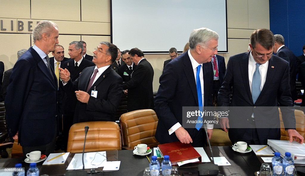 British Defence minister Michael Fallon (R-2), US Defense Secretary Ashton Carter (R), Turkish Defense Minister Ismet Yilmaz (L-2) and Spanish Defense Minister Pedro Morenes Eulate (L) speak to each other prior to the start of a NATO Defence Ministers meeting at the NATO headquarter in Brussels, Belgium on February 10, 2016.