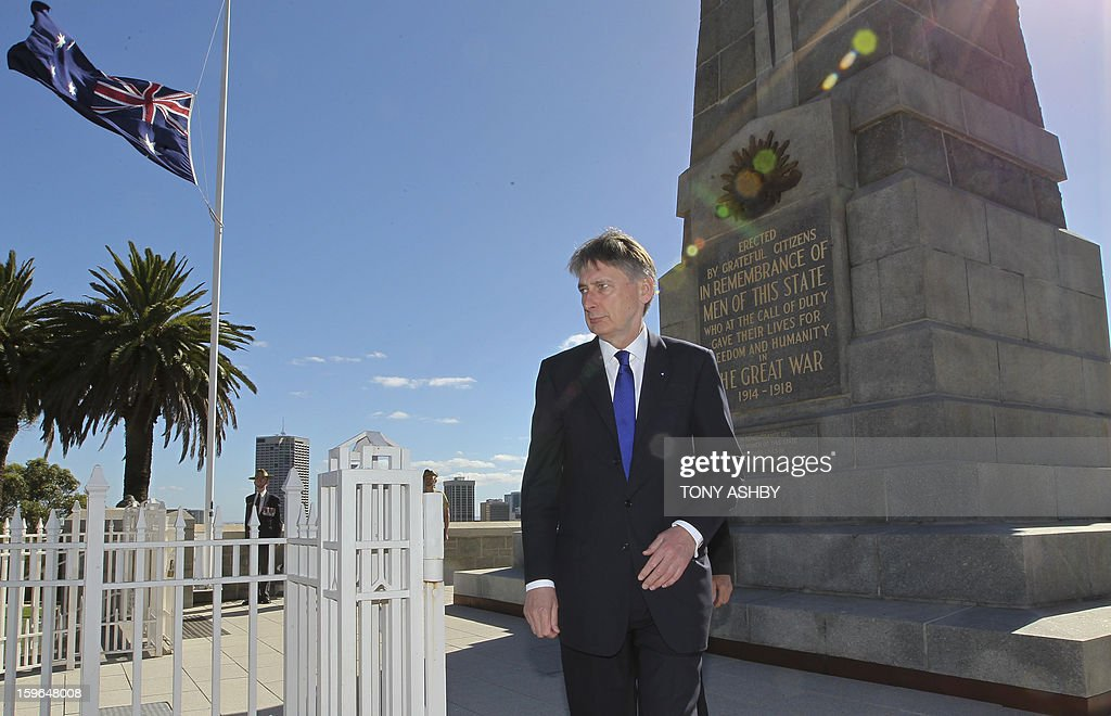 British Defence Minister Philip Hammond walks after laying a wreath at Perth's Kings Park War Memorial before the commencement of the Australia-UK Ministerial Consultations (AUKMIN) in Perth on January 18, 2013. The event is an annual day-long summit between the British Foreign Secretary and Defence Minister and their Australian counterparts. AFP PHOTO / POOL / Tony ASHBY