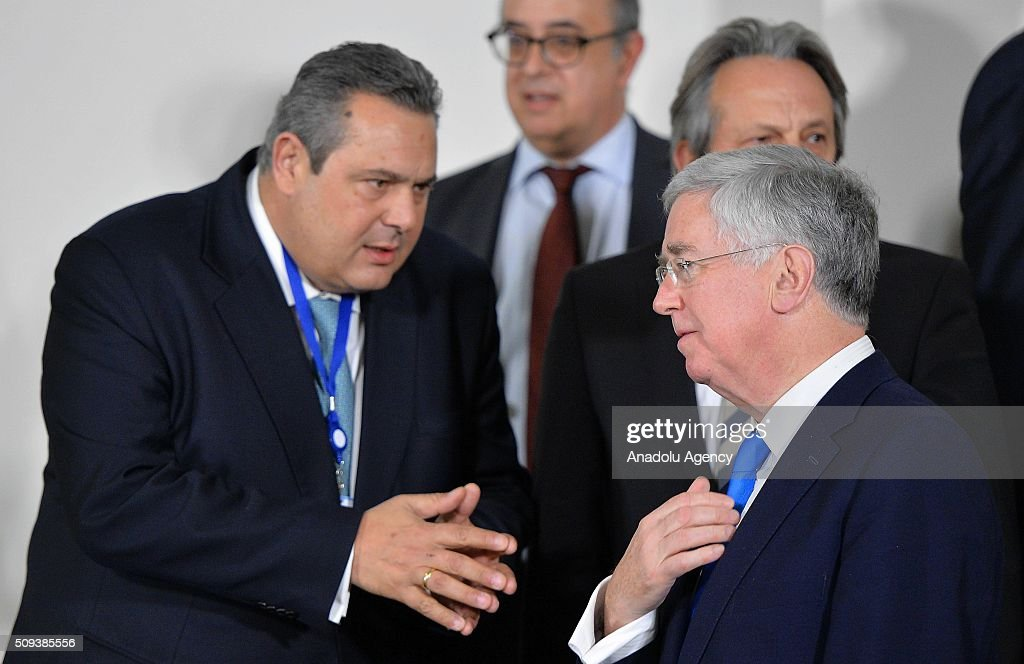 British Defence secretary Michael Fallon (right) and Greek Defence Minister Panos Kammenos (left) attend the NATO Defense Ministers meeting at the NATO headquarters in Brussels, Belgium on February 10, 2016.