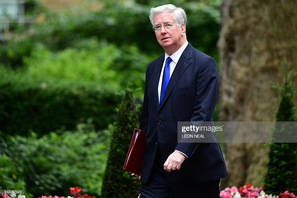 British Defence Secretary Michael Fallon arrives to attend a cabinet meeting at 10 Downing Street in central London on June 27, 2016. European stock markets mostly slid Monday as British finance minister George Osborne attempted to calm jitters after last week's shock Brexit referendum. Britain's surprise referendum decision to leave the European Union wiped $2.1 trillion off market valuations on Friday and sent the pound collapsing to a 31-year low against the dollar. / AFP / LEON