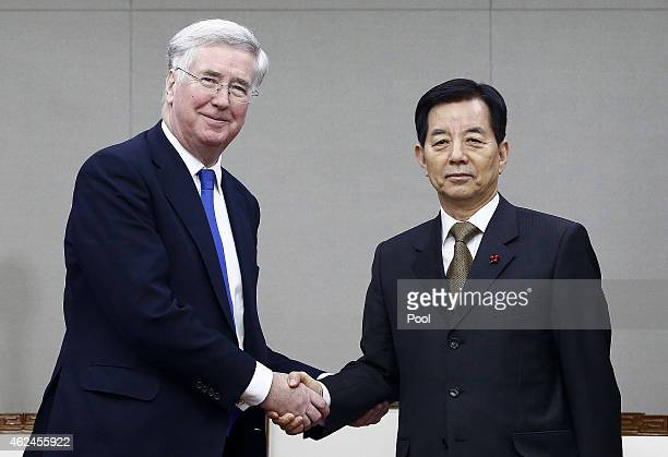 British Defence Secretary Michael Fallon shakes hands with South Korean defense minister Han MinKoo prior their meeting at the Ministry of National...