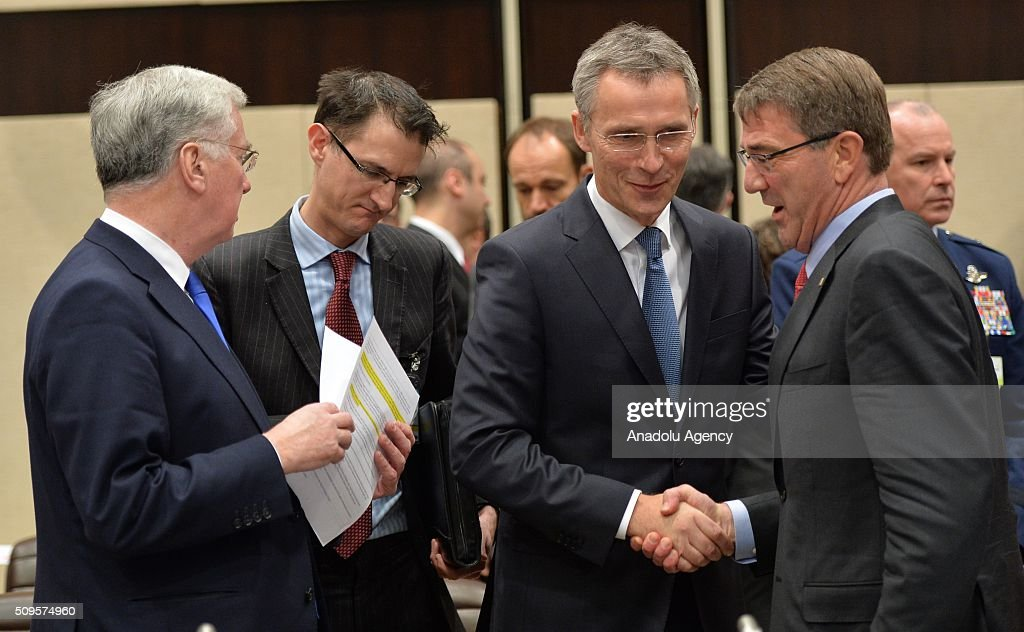 British Defence secretary Michael Fallon (L), United States Secretary of Defense Ash Carter (R) and NATO Secretary General Jens Stoltenberg (right 2) attend the anti-Daesh coalition conference at NATO headquarters in Brussels, Belgium on February 11, 2016. The counter-Deash defense ministers conference, in Brussels, comprises 27 nations, including the United States, that provide force contributions to the counter-Daesh campaign.