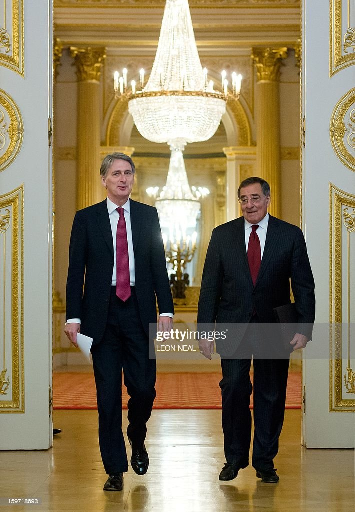 British Defence Secretary Philip Hammond (L) and US Defence Secretary Leon Panetta (R) enter the room for a joint press conference in Lancaster House, central London, on January 19, 2013. Hammond said the hostage crisis in Algeria had been ended by the Algerian military with loss of life, which he blamed squarely on the Islamist kidnappers.