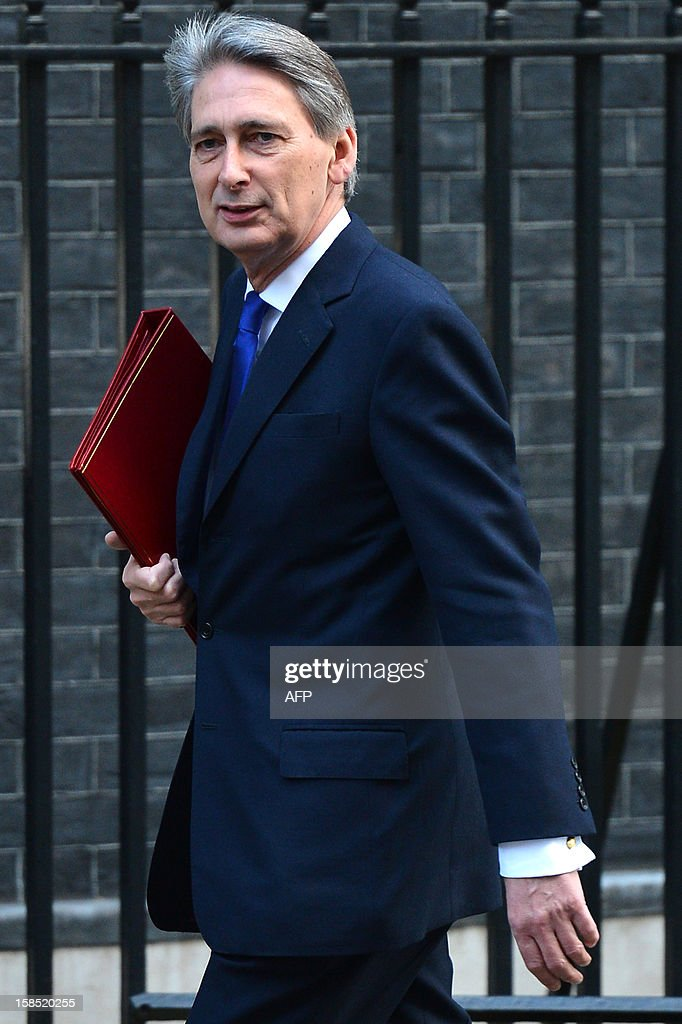 British Defence Secretary Philip Hammond arrives in Downing Street to attend the Cabinet meeting in central London on December 18, 2012. Britain's Queen Elizabeth II attended her first-ever cabinet meeting to mark her diamond jubilee.