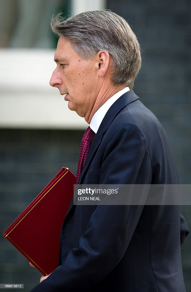 British Defence Secretary Philip Hammond arrives to attend a meeting with government's emergency response committee, COBRA, in Downing Street in central London on May 23, 2013. Britain's national security chiefs were meeting as counter-terrorism police investigated the murder of a soldier who was hacked to death in a London street by two suspected Islamic extremists. AFP PHOTO/Leon Neal