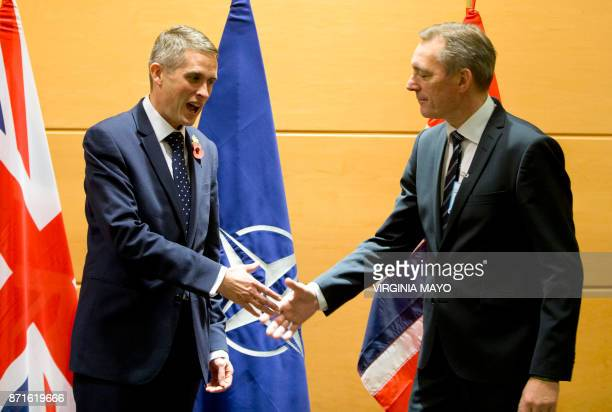 British Defense Secretary Gavin Williamson shakes hands with his Norwegian counterpart Frank BakkeJensen prior to a meeting on the sidelines of a...