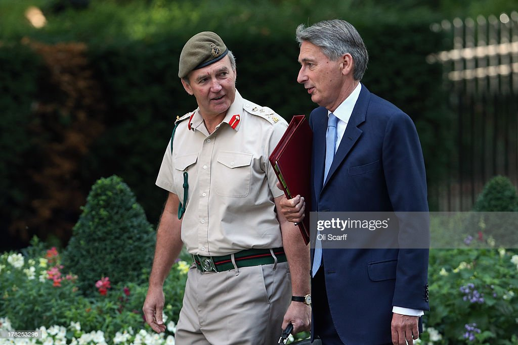 British Defense Secretary <a gi-track='captionPersonalityLinkClicked' href=/galleries/search?phrase=Philip+Hammond&family=editorial&specificpeople=2486715 ng-click='$event.stopPropagation()'>Philip Hammond</a> (R) arrives in Downing Street with the Chief of the Defense Staff, General Sir Nick Houghton, on August 28, 2013 in London, England. Prime Minister David Cameron is due to Chair a meeting of the National Security Council today before Parliament's recall tomorrow to debate the UK's response to a suspected chemical weapon attack in Syria.