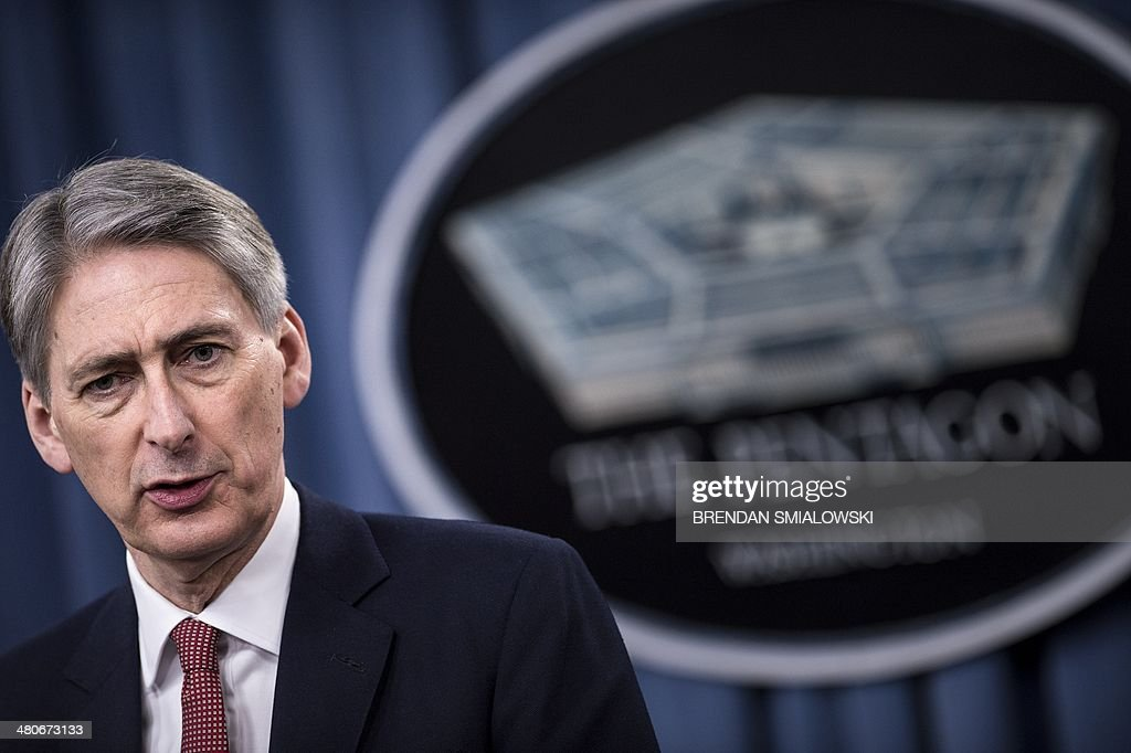 British Defense Secretary Philip Hammond speaks during a press conference at the Pentagon on March 26, 2014 in Washington, DC. US Secretary of Defense Chuck Hagel and Hammond held the briefing after a bilateral meeting earlier at the Pentagon where they spoke about the Ukraine and other issues. AFP PHOTO/Brendan SMIALOWSKI