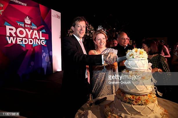 British Deputy High Commissioner to India Nigel Casey cuts a wedding cake with his wife Clare Casey at a function in the High Commissioners residence...