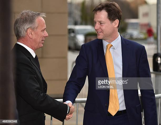 British Deputy Prime Minister and leader of the Liberal Democratic Party Nick Clegg arrives at ITV Studios in Salford north west England on April 2...