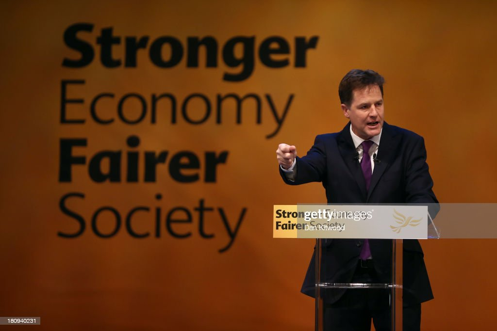 British Deputy Prime Minister and Leader of the Liberal Democrats <a gi-track='captionPersonalityLinkClicked' href=/galleries/search?phrase=Nick+Clegg&family=editorial&specificpeople=579276 ng-click='$event.stopPropagation()'>Nick Clegg</a> delivers his key-note speech to delegates at the end of the Liberal Democrat Autumn Party Conference at the SECC, Scottish Exhibition and Conference Centre on September 18, 2013 in Glasgow, Scotland. At the end of the five day event, the party leader brought the conference to a close with his keynote speech, rallying his party and insisting that they support the coalition government in order to keep the country on the right path.