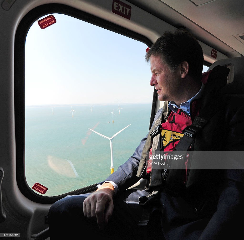 British Deputy Prime Minister <a gi-track='captionPersonalityLinkClicked' href=/galleries/search?phrase=Nick+Clegg&family=editorial&specificpeople=579276 ng-click='$event.stopPropagation()'>Nick Clegg</a> looks out of a helicopter window over the new Centrica Energy Lincs offshore wind farm off the Lincolnshire coast on August 1, 2013 near Grimbsy, England. <a gi-track='captionPersonalityLinkClicked' href=/galleries/search?phrase=Nick+Clegg&family=editorial&specificpeople=579276 ng-click='$event.stopPropagation()'>Nick Clegg</a> has launched a seven-year plan to boost offshore wind farms and create 26,000 new jobs while transforming sea-based turbine energy into a potential GBP7 billion-a-year business by the year 2020.
