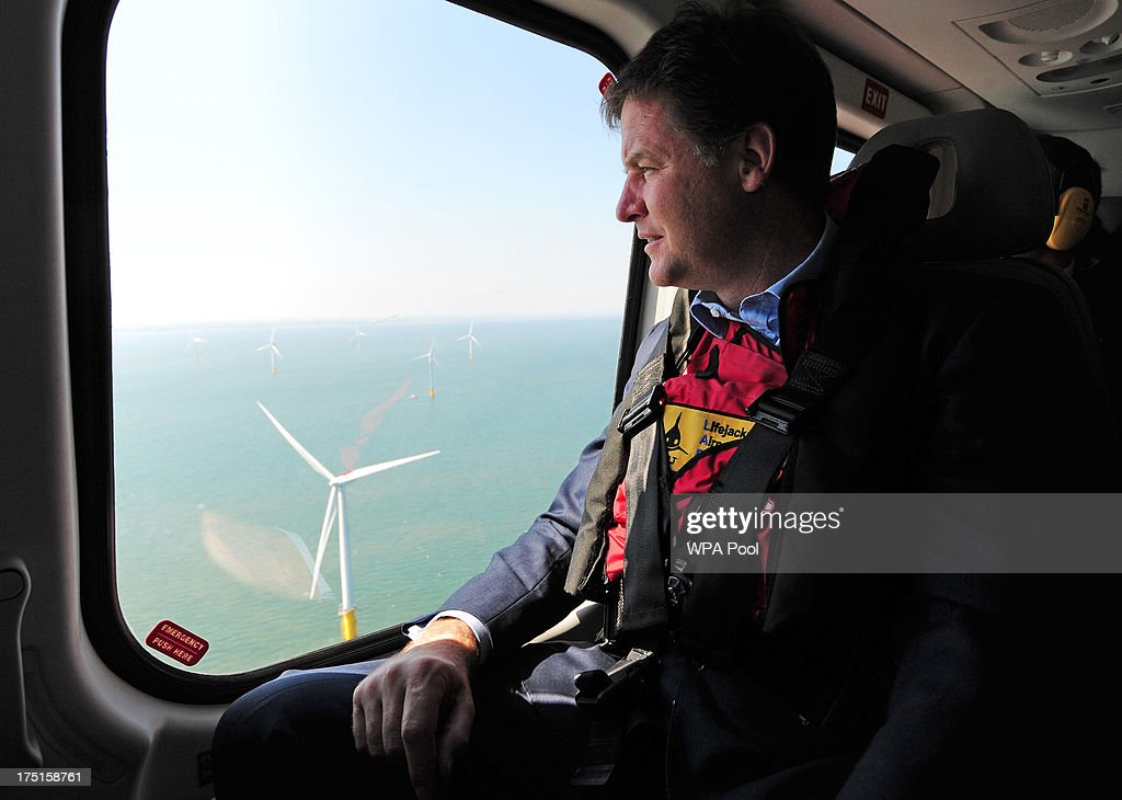 British Deputy Prime Minister Nick Clegg looks out of a helicopter window over the new Centrica Energy Lincs offshore wind farm off the Lincolnshire coast on August 1, 2013 near Grimbsy, England. Nick Clegg has launched a seven-year plan to boost offshore wind farms and create 26,000 new jobs while transforming sea-based turbine energy into a potential GBP7 billion-a-year business by the year 2020.