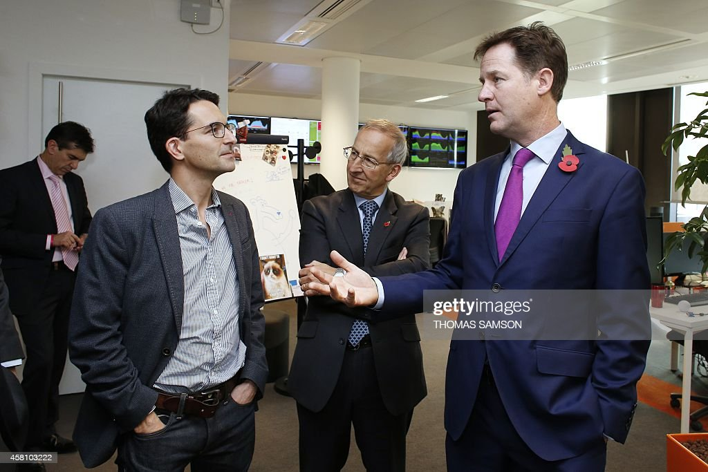 British Deputy Prime Minister Nick Clegg speaks with Criteo Chief Product Officer Jonathan Wolf during a visit of the headquarters of online...