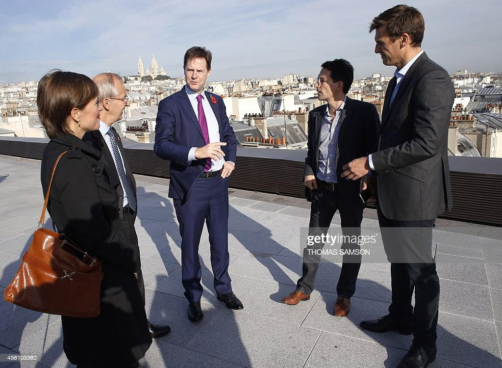 British Deputy Prime Minister Nick Clegg speaks with Criteo Chief Product Officer Jonathan Wolf and Managing Director Europe Gregory Bazagne during a...