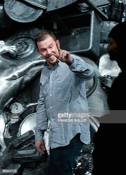 British designer Alexander McQueen gestures at the end of his autumn/winter 2009 readytowear collection show in Paris on March 10 2009 AFP PHOTO...