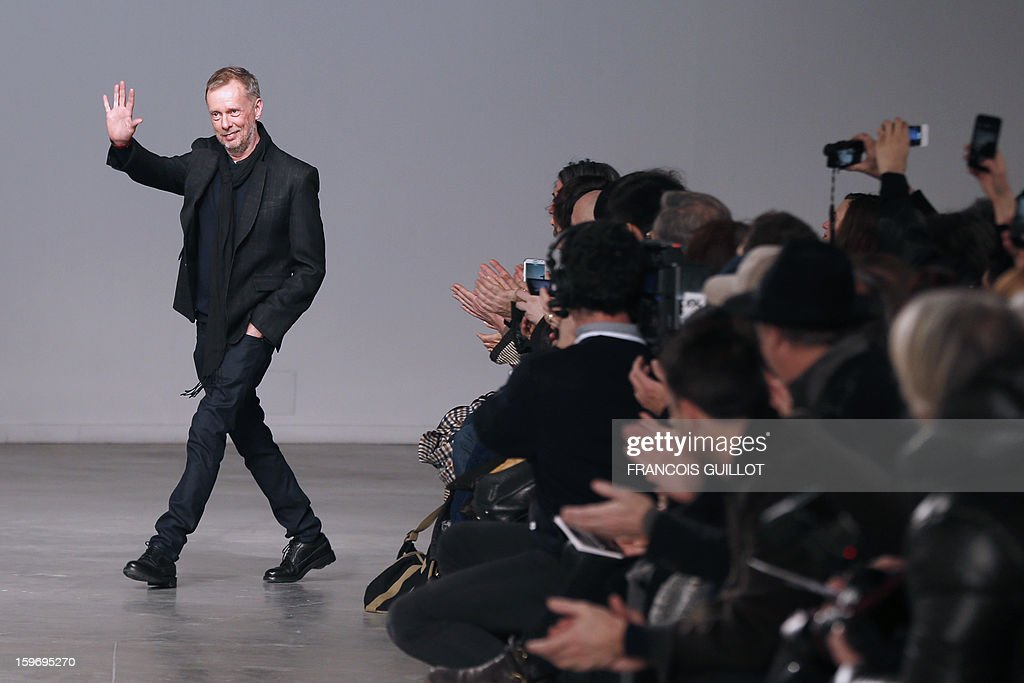 British designer Bill Gaytten acknowledges the audience at the end of John Galliano men's Fall-Winter 2013-2014 collection show on January 18, 2013 as part of the Men's fashion week in Paris.