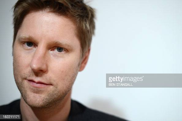 British designer Christopher Bailey poses backstage ahead of his Burberry Prorsum 2013 spring/summer collection catwalk show at London Fashion Week...