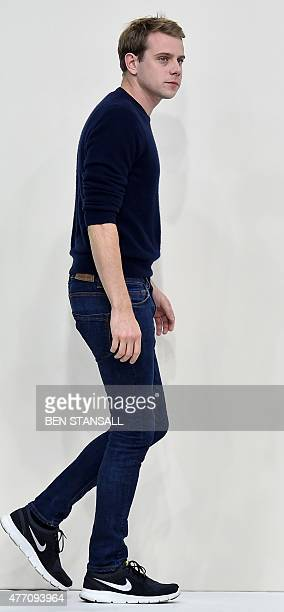 British designer J W Anderson walks on the catwalk following a fashion show of his designs on the third day of the Spring/Summer 2016 London...