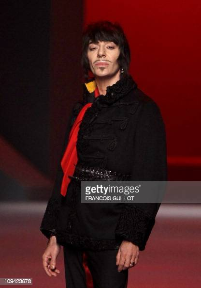 British designer John Galliano acknowledges the public after the Christian Dior SpringSummer 2011 Haute Couture Collection Show on January 24 in...