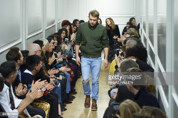 British designer Jonathan Anderson greets the crowd after his catwalk show on the second day of the Autumn/Winter 2017 London Fashion Week in London...