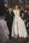 British designer Julien Macdonald acknowledges the audience after presenting his collection during the Spring / Summer 2016 London Fashion Week in...