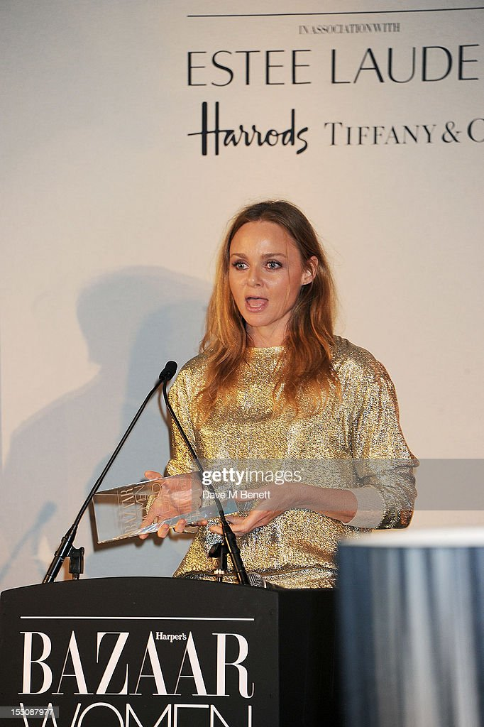 (MANDATORY CREDIT PHOTO BY DAVE M BENETT/GETTY IMAGES REQUIRED) British Designer of the Year winner Stella McCartney accepts her award at the Harper's Bazaar Women of the Year Awards 2012, in association with Estee Lauder, Harrods and Tiffany & Co., at Claridge's Hotel on October 31, 2012 in London, England.