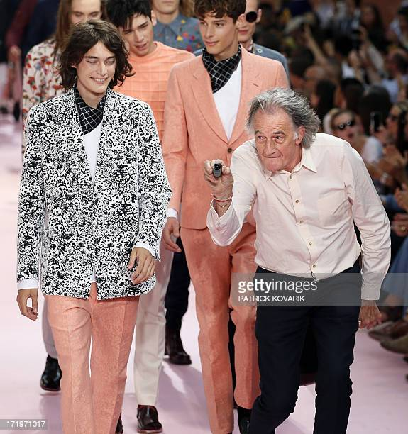British designer Paul Smith acknowledges the public during the men's spring/summer 2014 readytowear fashion show on June 30 2013 in Paris AFP PHOTO /...