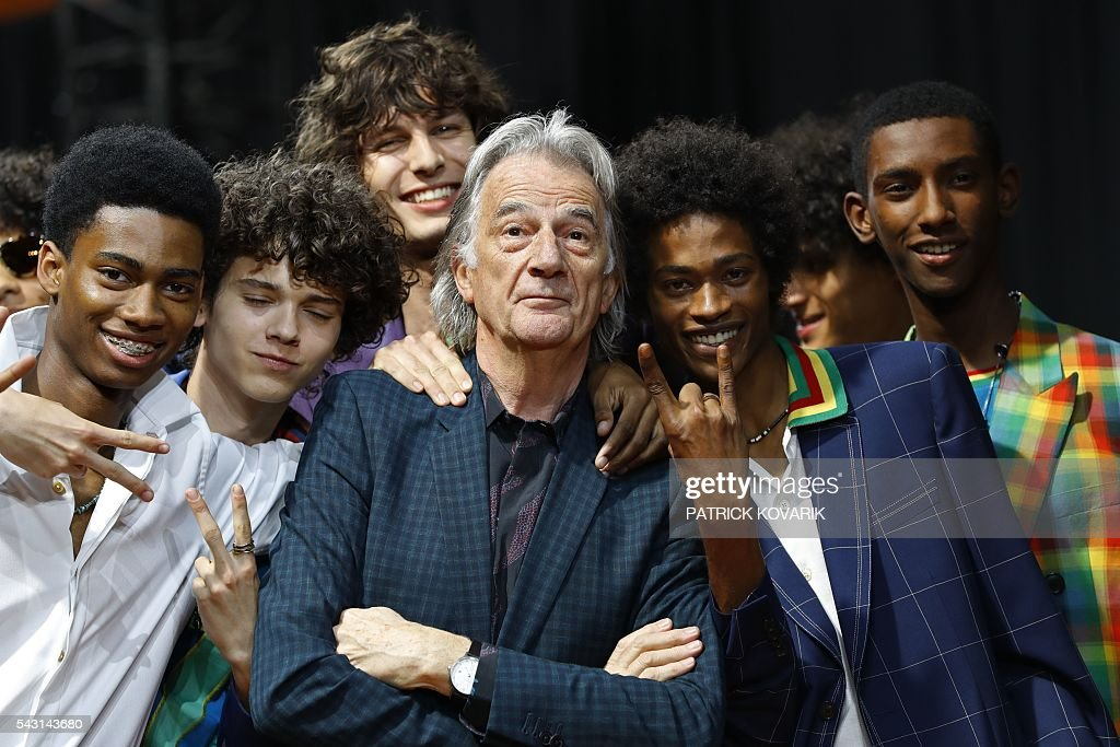 British designer Paul Smith (C) poses with models after his men's Spring/Summer 2017 collection fashion show on June 26, 2016 in Paris. / AFP / PATRICK