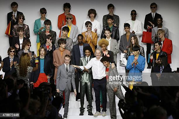 British designer Paul Smith poses with models during the Men's Fashion Week for the 2016 spring/summer collections in Paris on June 28 2015 AFP PHOTO...
