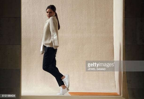 British designer Victoria Beckham greets the audience after presenting her creations during the Fall 2016 New York Fashion Week on February 14 in New...