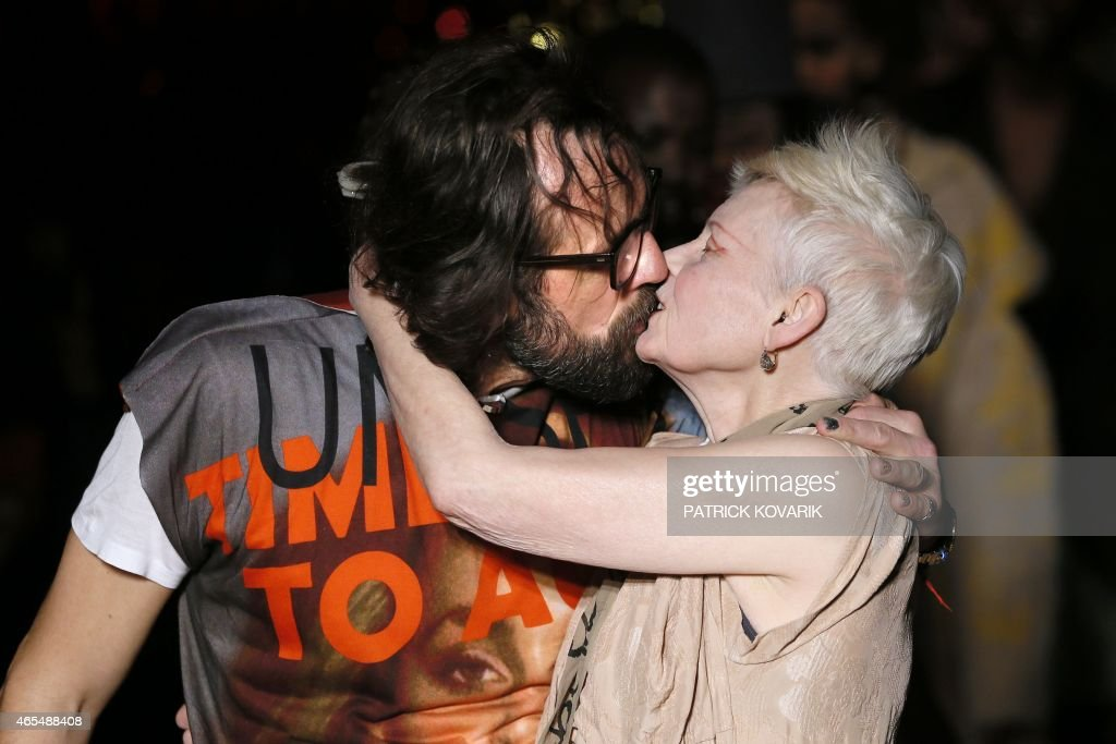 British designer Vivienne Westwood kisses her husband Andreas Kronthaler after her 20152016 fall/winter readytowear collection fashion show on March...