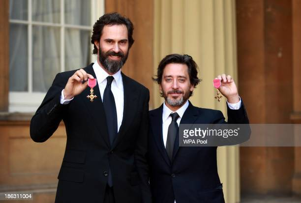 British designers Edward Barber OBE Jay Osgerby OBE hold their Officer of the Most Excellent Order of the British Empire medals after an Investiture...