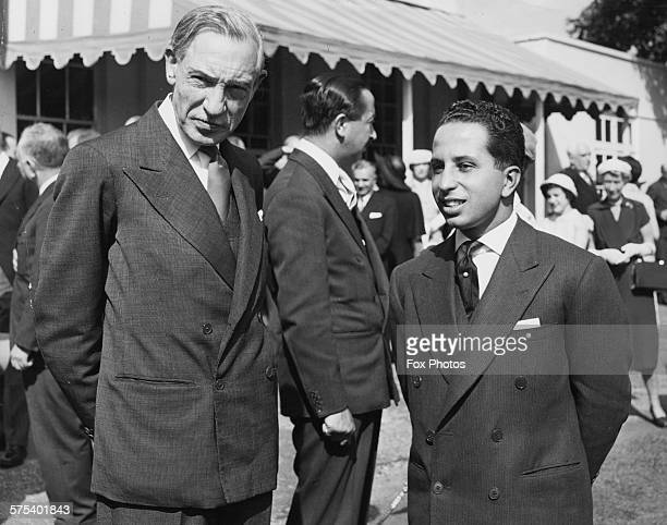 British diplomat Sir John Troutbeck and King Faisal of Iraq with Crown Prince Abdul Illah in the background in conversation at a garden party held by...