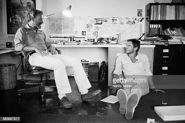 American producer screenwriter and director Georges Lucas and actor Harrison Ford in his home of Los Angeles Ford stars in Lucas's superproduction...