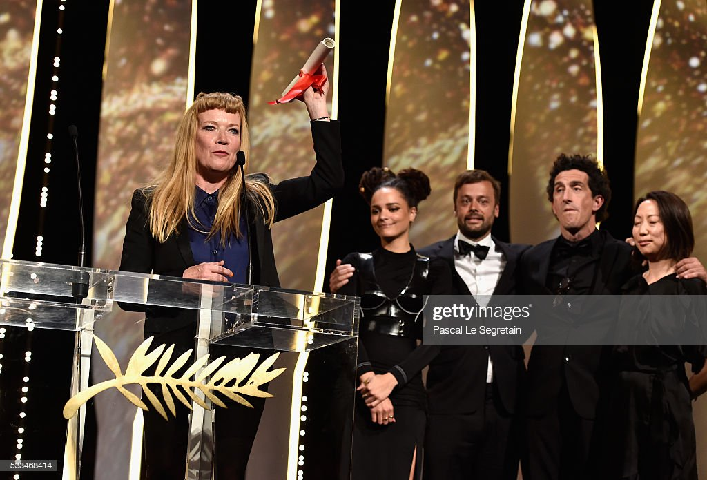 British director <a gi-track='captionPersonalityLinkClicked' href=/galleries/search?phrase=Andrea+Arnold&family=editorial&specificpeople=606927 ng-click='$event.stopPropagation()'>Andrea Arnold</a> (L) celebrates on stage with (L-R) actress <a gi-track='captionPersonalityLinkClicked' href=/galleries/search?phrase=Sasha+Lane&family=editorial&specificpeople=15806136 ng-click='$event.stopPropagation()'>Sasha Lane</a>, producer <a gi-track='captionPersonalityLinkClicked' href=/galleries/search?phrase=Lars+Knudsen&family=editorial&specificpeople=4164904 ng-click='$event.stopPropagation()'>Lars Knudsen</a> and Robbie Ryan after being awarded with the Jury Prize for the film 'American Honey' during the closing ceremony of the annual 69th Cannes Film Festival at Palais des Festivals on May 22, 2016 in Cannes, France.
