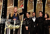 British director Andrea Arnold celebrates on stage with actress Sasha Lane producer Lars Knudsen and Robbie Ryan after being awarded with the Jury...