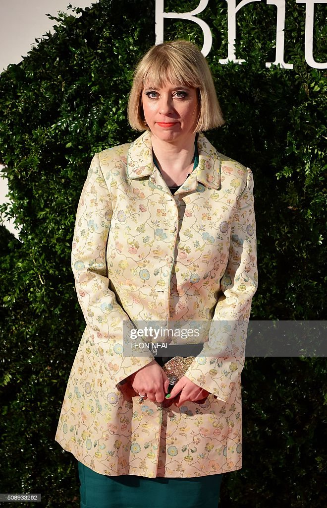 British director Carol Morley poses on arrival for the British film awards in central London on February 7, 2016. / AFP / LEON NEAL