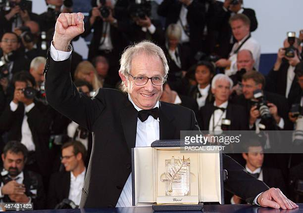 British director Ken Loach celebrates during a photocall after winning the Palme d'Or during the closing ceremony of the 58th edition of the Cannes...