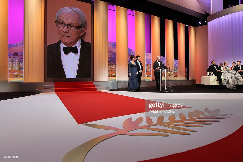 British director Ken Loach (C) delivers a speech after being awarded with the Prix du Jury (Jury Prize) for his film 'The Angel's Share' during the 65th Cannes film festival on May 27, 2012 in Cannes. AFP PHOTO / VALERY HACHE