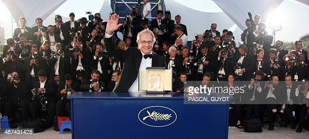 British director Ken Loach poses during a photocall after winning the Palme d'Or during the closing ceremony of the 58th edition of the Cannes...