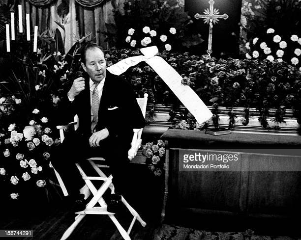 British Director Terence Young on the set of the movie Joe Valachi I segreti di Cosa Nostra directed by himself next to the catafalque of Gaetano...