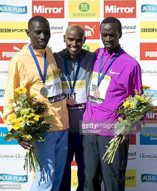 British distance runner Mo Farah celebrates victory in the Great North Run halfmarathon with second place finisher Kenyan Stanley Biwott and third...