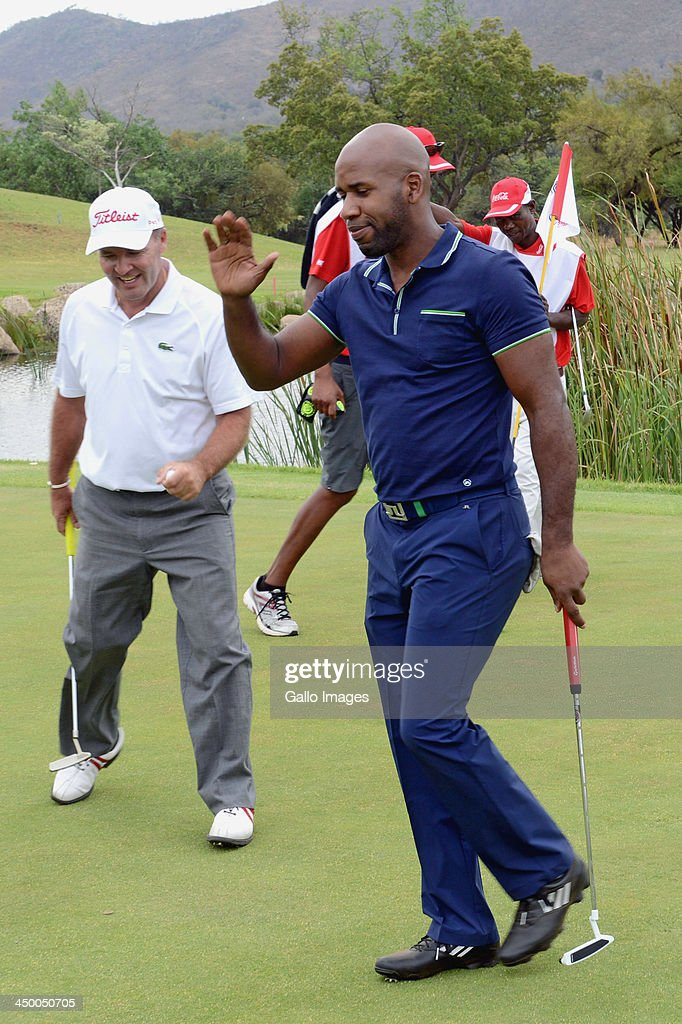 British DJ Spoony (Jonathan Joseph) plays a shot during Round 1 of the Gary Player Invitational presented by Coca-Cola at the Lost City Golf Course on November 16, 2013 in Sun City, South Africa.