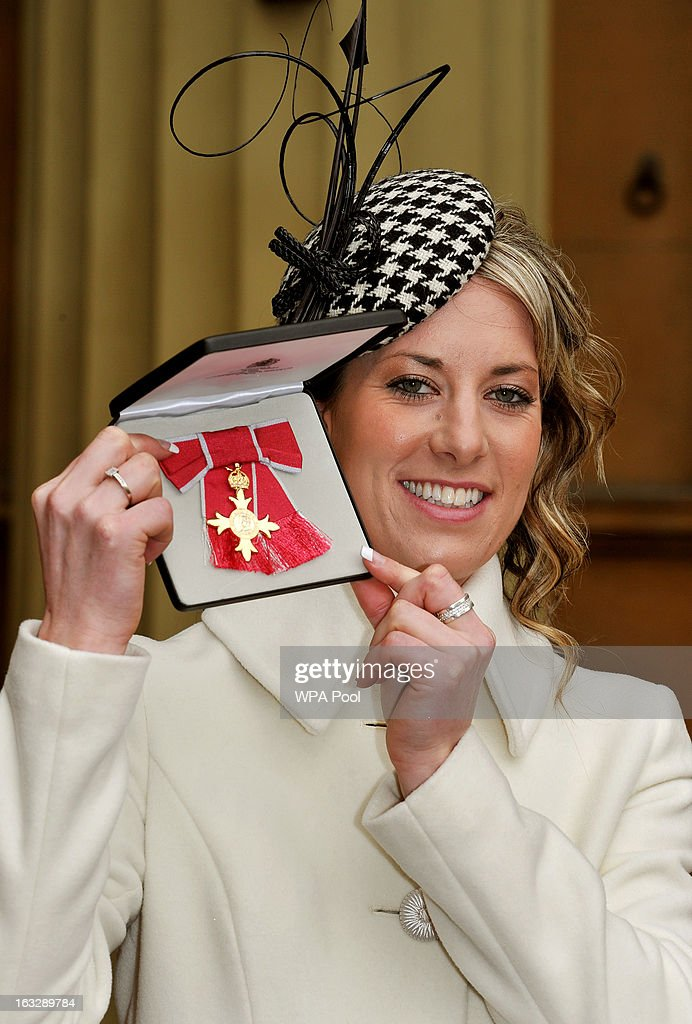 British dressage rider and double gold medal winner at the 2012 Summer Olympics Charlotte Dujardin proudly holds her OBE award after the Investiture Ceremony at Buckingham Palace on March 07, 2013 in London, England.
