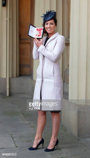 British dressage rider Charlotte Dujardin poses with her medal after she was appointed a Commander of the Order of the British Empire For services to...